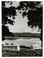 Northland - Buildings - Historic Publicity Caption Mangungu Mission House with St John's Community Church (right) on the shores of the Hokianga River. Photographer T. Hann.jpg