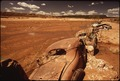 OLD CARS SERVE AS WATER-BREAK ON NAVAJO RESERVATION - NARA - 544433.tif
