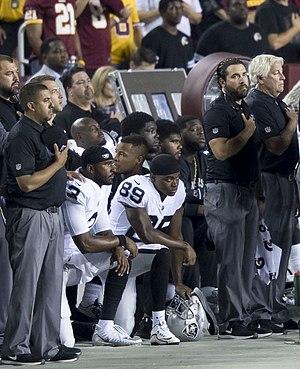 Oakland Raiders National Anthem Kneeling (37444579735) (cropped).jpg