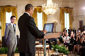 Barack Obama on social media - Barack Obama in the first presidential Twitter town hall meeting with service creator and moderator Jack Dorsey looking on.