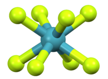 A greenish-blue central atom surrounded by and bonded to eight yellowish-green atoms arranged in a square antiprismatic fashion.