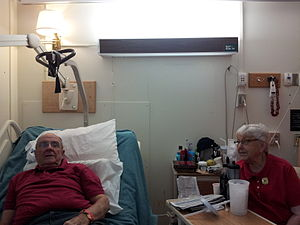 Fort Boise - An octogenarian veteran of Allied-occupied Austria recuperates after a ischium fracture at the Boise VA Medical Center's Community Living Center with his wife at his side