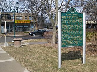 Okemos, Michigan - Chief Okemos sign at the Four Corners of Okemos, Michigan