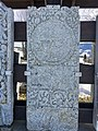 Old tombstones on display at the graveyard (kirkegård) by Sør-Fron Church (Gudbrandsdalsdomen kirke 1792) Hundorp Gubrandsdalen Norway 2017-03-23 Spring sun IMG 1955.jpg