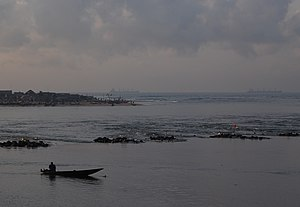 Cotonou - The Oueme River as it flows into the Atlantic Ocean at Cotonou