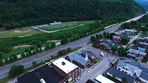 Harlan, Kentucky - A view of U.S. Route 421 from downtown; the flood wall and Harlan Independent Schools' athletic fields are also visible.