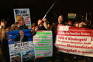 "Pegida - ""Putin, hilf uns, rette uns!"" (""Putin, help us, save us!"") and other slogans on signs and banners"