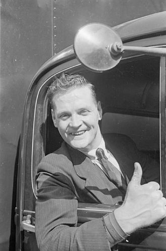 Thumb signal - A lorry driver giving a thumb sign in Britain, 1940