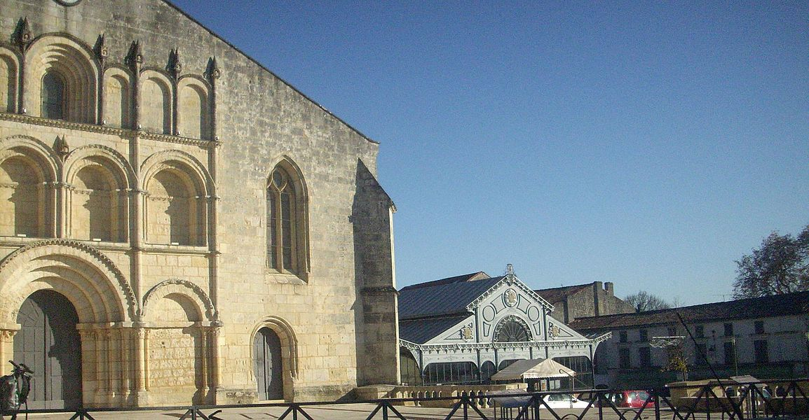 Square in front of the Saint Gervais Saint Protais church, with the market place in the back. Jonzac, Charente-Maritime (17), France