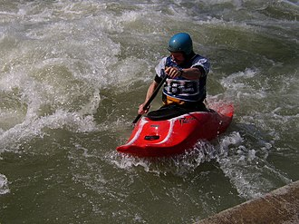 Whitewater canoeing - A whitewater canoer during Eurocup Playboating (Canoe-Freestyle), on the Eiskanal in Augsburg, Germany
