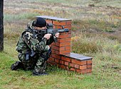 Polish special operations soldier fires with a G36