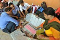 Polling officials checking the Electronic Voting Machine (EVM) and other necessary belongings for use in the General Assembly Elections, at Sarusaghai, Guwahati, in Assam on April 10, 2016.jpg