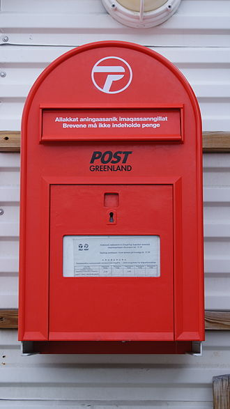 POST Greenland - A red postbox of Post Greenland by the entrance to the Uummannaq Heliport