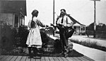 Postman delivering mail, location unknown, ca 1910 (INDOCC 223).jpg