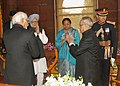 Pranab Mukherjee being welcomed by the Vice President and Chairman Rajya Sabha, Shri Mohd. Hamid Ansari, the Speaker, Lok Sabha, Smt. Meira Kumar and the Prime Minister.jpg
