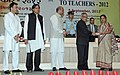 Pranab Mukherjee presenting the National Award for Teachers-2012 to Smt. Nigar Anjum Khan, Chhattisgarh, on the occasion of the 'Teachers Day', in New Delhi. The Union Minister for Human Resource Development.jpg