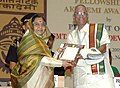 Pratibha Devisingh Patil presenting the Sangeet Natak Akademi Award-08 Carnatic Instrumental Music (Mridangam) to Shri Mannargudi A. Easwaran for his contribution to Carnatic Instrumental Music.jpg