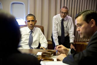 John Podesta - President Obama holds a meeting with John Podesta and Susan Rice aboard Air Force One, 2015