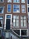 foto van Huis met halsgevel met deurkalf en bovenlicht