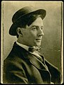 Profile of the painter Tom Thomson wearing a hat.jpg