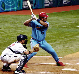 Albert Pujols at bat, wearing a 1982 retro jer...