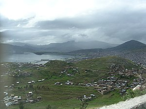 Puno Province - Puno, the capital of the region, and Lake Titicaca as seen from Puma Uta viewpoint