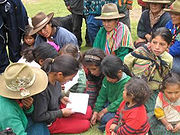 Peruvian indigenous people, learning to read.