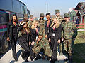 Raiderettes pose with troops.jpg