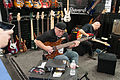 Randy George checks out some Regenerate basses - 2014 NAMM Show.jpg
