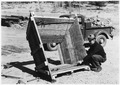 Ranger shows a box used to move trees during transplanting - NARA - 286043.tif