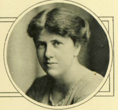 A photograph of the head and shoulders of a woman