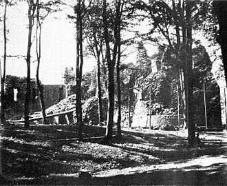 Castell Coch - Reconstruction of the castle in 1875, with a temporary bridge across the ditch (left) and the ruined Well Tower (right)