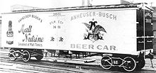 Photograph of an early refrigerated railroad car with Anheuser-Busch beer advertisements