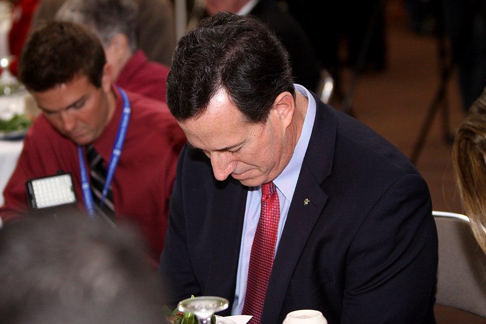 Rick Santorum prays