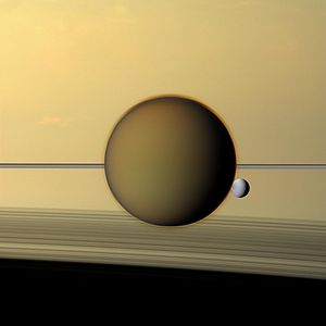 Titan Mare Explorer - Titan in front of Dione and Saturn