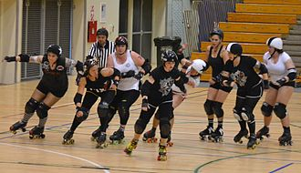 Aotearoa Roller Derby - Roller Derby Team New Zealand Probables v. Possibles bout, 22 October 2011.  World Cup MVP, Skate the Muss, second from left.
