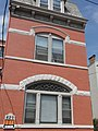 Rowhouse with large arched windows (4763099654).jpg