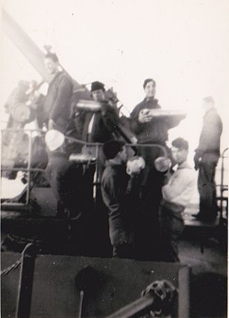 Liberty ship - Seamen during shell loading practice aboard SS Lawton B. Evans in 1943