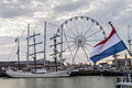 Sail boats and a Ferris wheel in Harlingen Harbor during the Tall Ship races of 2014.jpg