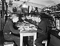 Sailors sit for dinner on board a Royal Navy trawler at Dover, October 1941. A5913.jpg