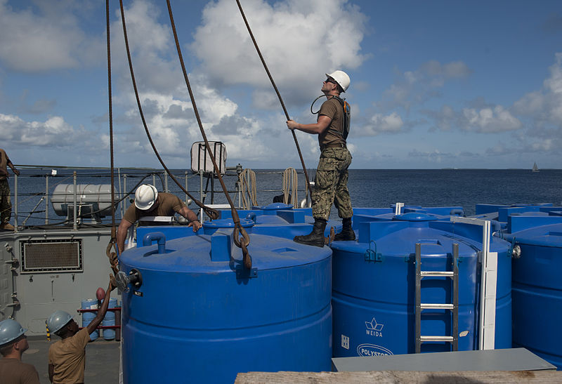 File:Sailors unload a reverse osmosis water system. (9250286164).jpg