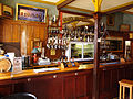 Saloon of Golden Nugget Hotel, Shantytown Historical Park New Zealand.jpg