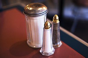 Salt and pepper shakers - Salt and pepper shakers, along with a sugar dispenser