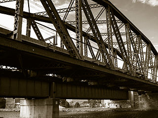 Saltwater River Rail Bridge steel arch truss railway bridge crossing the Maribyrnong River (formerly Saltwater River) on the Melbourne to Footscray railway in Melbourne, Victoria
