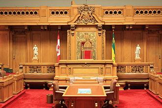 Saskatchewan Legislative Building - The legislative chamber inside the Saskatchewan Legislative Building with its original red carpet