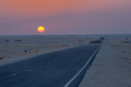 Dukhan Highway connects the city of Dukhan on the West coast of the country with the country's capital, Doha. Service road near Dukhan Highway.jpg