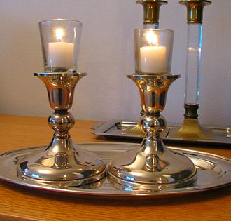 "Jewish holidays - Candles are lit on the eve of the Jewish Sabbath:)(""Shabbat"") and Jewish holidays."