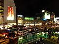 Shinjuku Station south exit at night.jpg