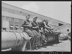 Shipyard workers eating on a torpedo 8d39918v.jpg