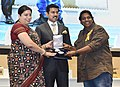 Smriti Irani presenting the Rajat Kamal Award to Ganesh Acharya (Best Choreography) for the Hindi film -TOILET EK PREM KATHA, at the 65th National Film Awards Function, in New Delhi.JPG